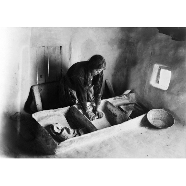 Hopi: Grinding Corn, C1911. /Na Hopi Woman Grinding Corn In A Dwelling In A