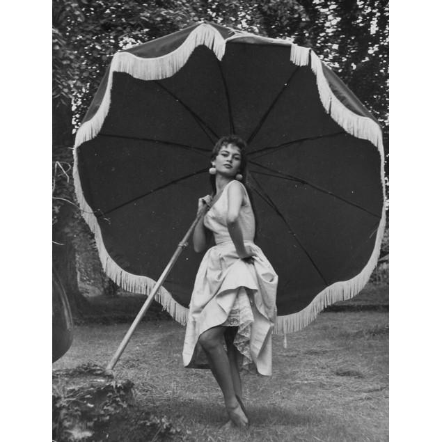 Brigitte Bardot holding an umbrella Poster