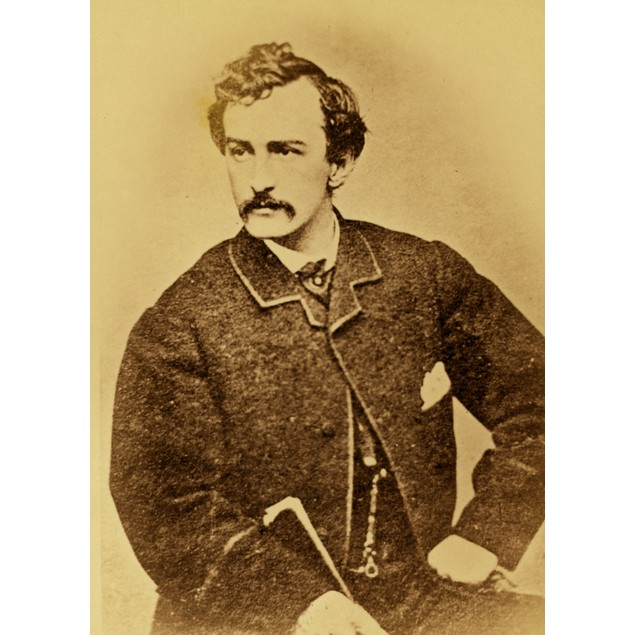 John Wilkes Booth, half-length portrait, facing left and holding a cane Pos