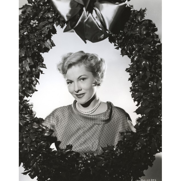 Joan Fontaine wearing a Pearl Necklace and Holding a Christmas Wreath Poste