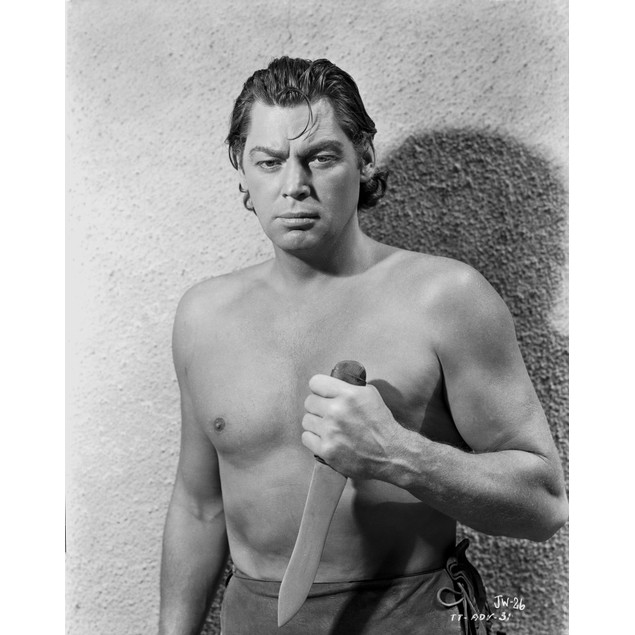 Johnny Weissmuller Holding a Knife in a Classic Movie Scene Poster