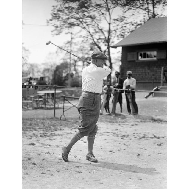 Golfing, 1924. /Na Man Golfing. Photograph, 1924. Poster