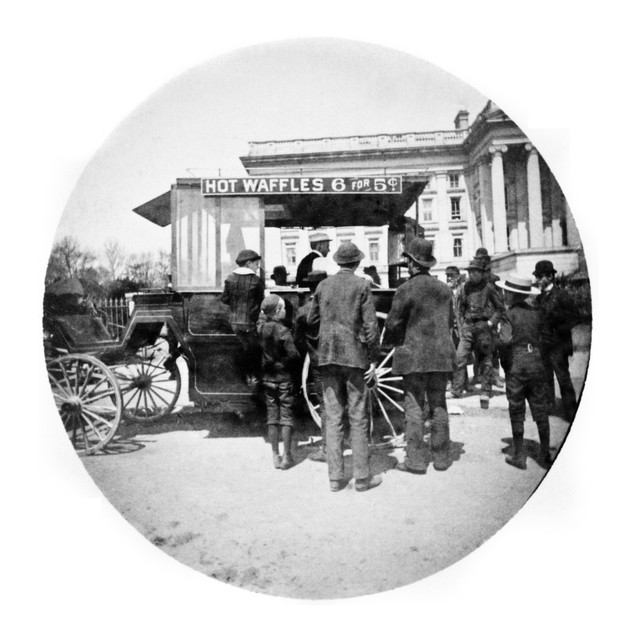 Waffle Vendor, 1889. /Ncrowd In Front Of A Waffle Vendor Outside Of The Tre