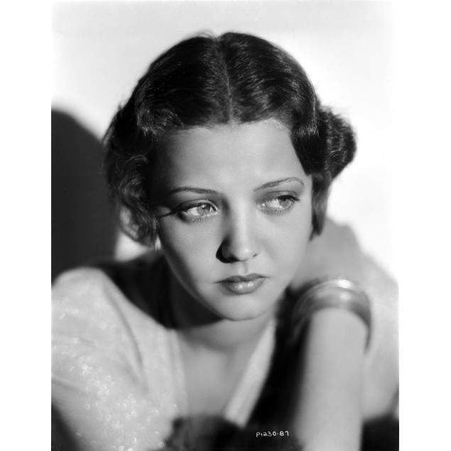 Sylvia Sidney Posed in a White Blouse with Bracelet Poster
