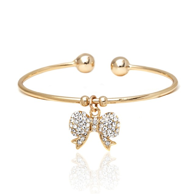 Gold Plated Sparkling Crystal Bow Charm Bangle