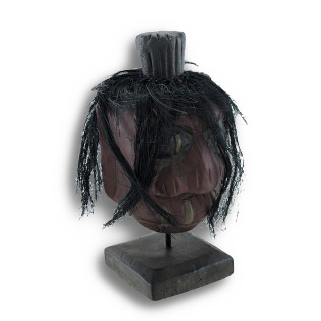 Mounted Shrunken Head With Stitching And Black Head Sculptures