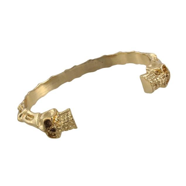 Polished Goldtone Finish Skulls And Bones Torc Womens Cuff Bracelets